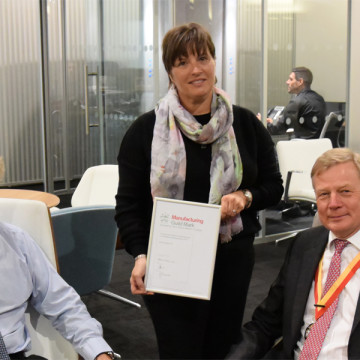 The Boss Design Group's Virginia Seaward, (Operations Manager) pictured centre, and Michael Holmes, (Commercial Director) pictured left, accepts the company's Manufacturing Guild Mark renewal certificate from Paul von der Heyde - Immediate Past Master at The Furniture Makers' Company.
